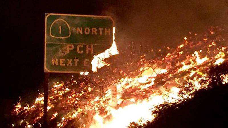 Freeway sign for the Pacific Coast Highway near Solimar Beach burns near Ventura on Saturday, Dec. 26, 2015. (image: KABC)