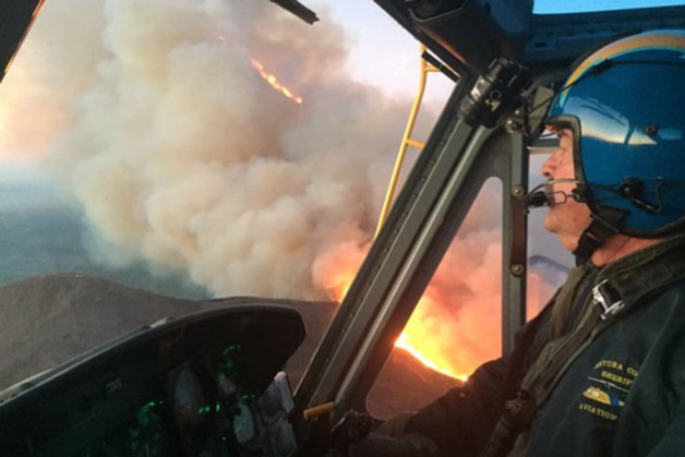 Solimar Fire from the cockpit of a Ventura County Air Unit Copter 7 making a pass on the morning of December 26, 2105 (image: tweet from Ventura County Air Unit).