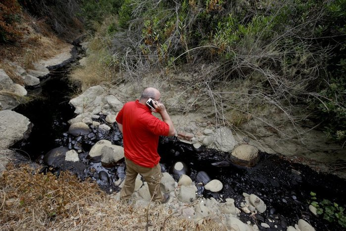 Sean speaking with reporters via cell phone from Prince Barranca in the hours after the onset of the Hall Canyon Oil Spill, June 23, 2016. Image: AP