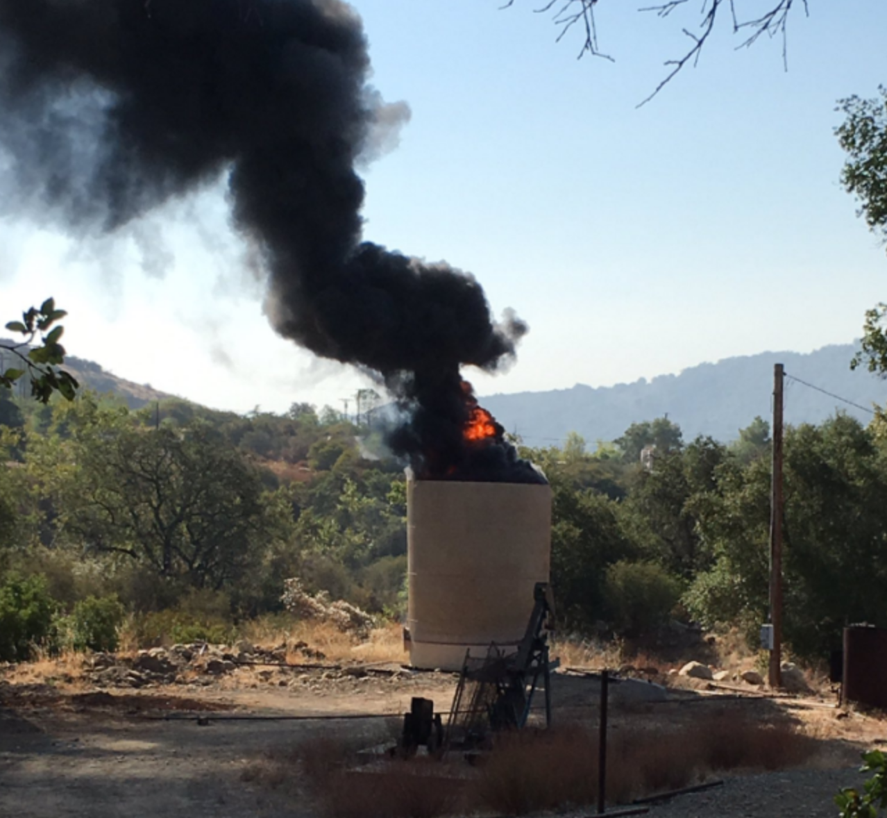 Ojai oil tank on fire, August 5, 2016.  Photo by Captain Mike Lindbery, Ventura County Fire Department.