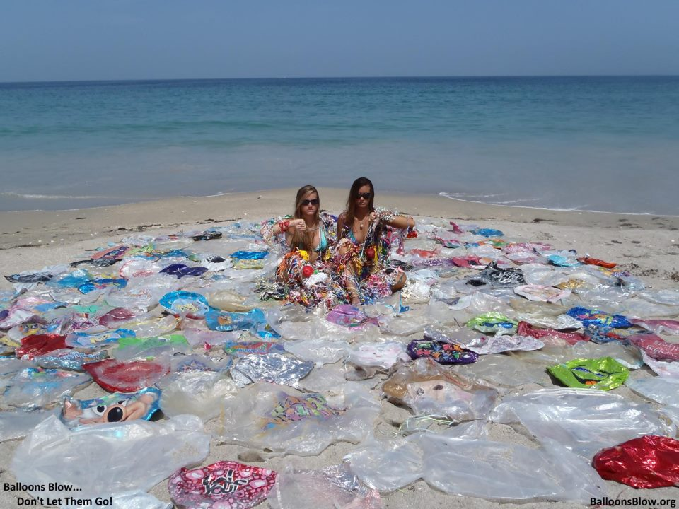 Balloons trash the beach.  Image from BalloonsBlow.